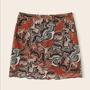 Abstract Print Mesh Mini Skirt